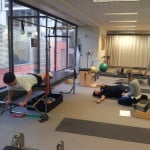 Pilates class picture bend and mend